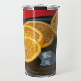 Sliced orange on the black plate and red background Travel Mug