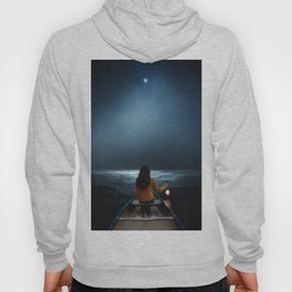 Woman in a boat in the ocean at night-Lantern Lights Hoody