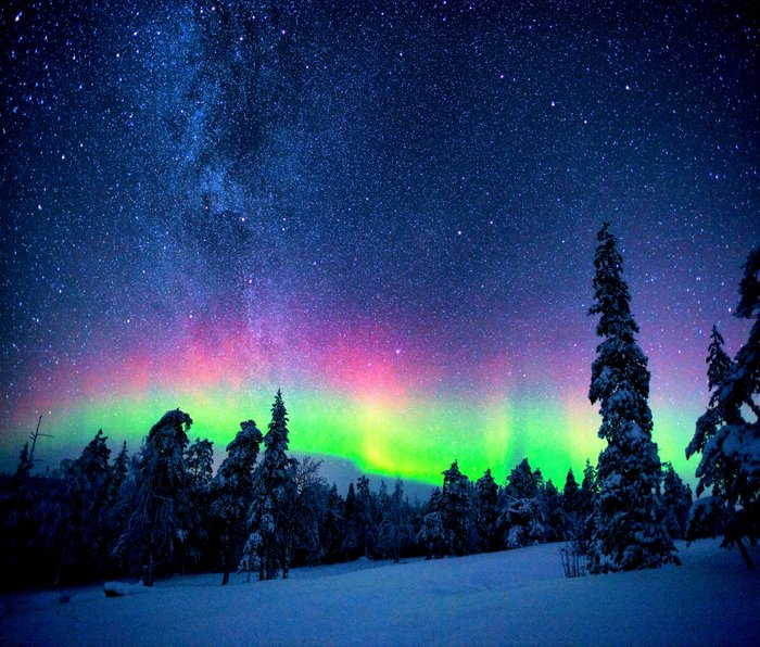 Aurora Borealis Over Wintry Mountains Travel Mug