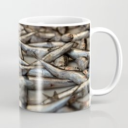 small silvery fish put on display to be sold. Fishes in the foreground and in the background unfocus Coffee Mug