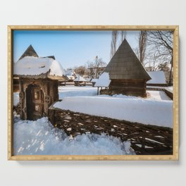 Traditional handcrafted gate and a rural Romanian homestead covered in snow Serving Tray