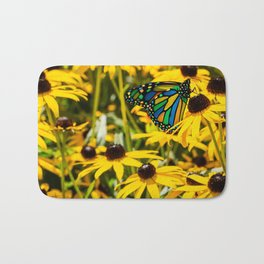 Surreal Monarch on Flowers Bath Mat