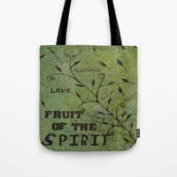 religious Tote Bags featuring Faith Religious Art---Fruit of the Spirit---Bible Scripture Galations 5:22 by Saribelle rodriguez by Saribelle Inspirational Art