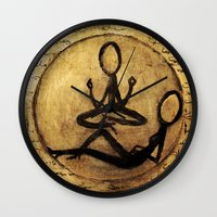 om Wall Clocks featuring om by woman