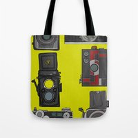 cameras Tote Bags featuring Cameras by Illustrated by Jenny
