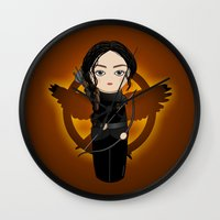 katniss Wall Clocks featuring Kokeshi Katniss by Pendientera