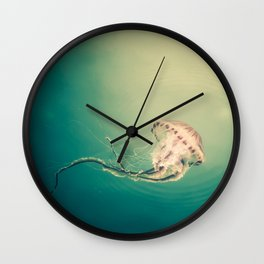 Lady Jellyfish is swimming in the calm sea of Trieste. Wall Clock