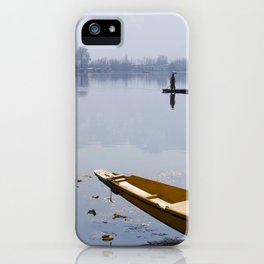 Small boat on the shore of Dal Lake in Srinagar, capital of Kashmir iPhone Case