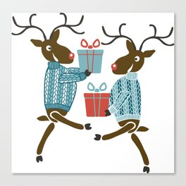 Funny christmas reindeer in sweaters with gifts Canvas Print