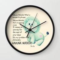 hakuna Wall Clocks featuring Hakuna Matata by Veronica Ventress