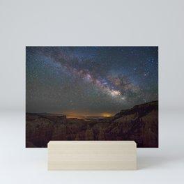 Night sky over canyon Mini Art Print