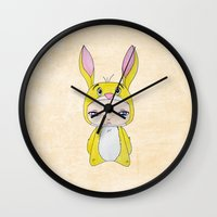 tigger Wall Clocks featuring A Boy - Rabbit (coco lapin) by Christophe Chiozzi