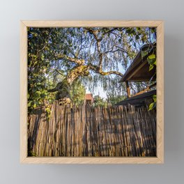 View to a fragile brown reed fence Framed Mini Art Print