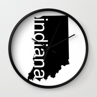 indiana Wall Clocks featuring Indiana by Isabel Moreno-Garcia
