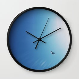 Flying to the sun Wall Clock