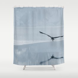 Gray heron flying over a frozen lake, Winter frozen lake. Shower Curtain