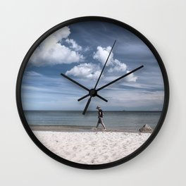 Lonely man at the beach Wall Clock