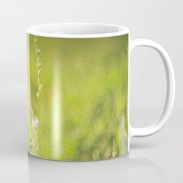 Wild flowers in the green meadow Coffee Mug
