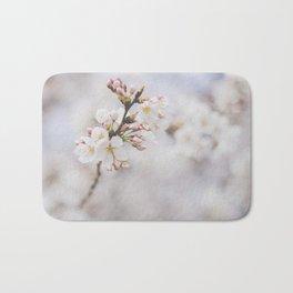 . delicate blossom . Bath Mat