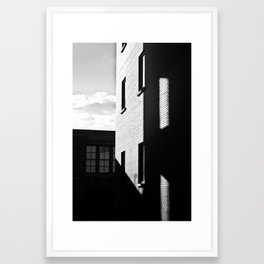 Brick Buildings with shadows Framed Art Print