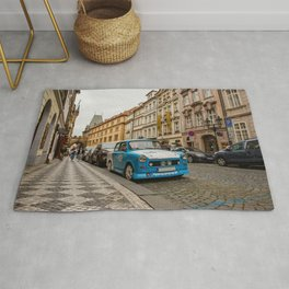 Trabant on the street of Prague Rug