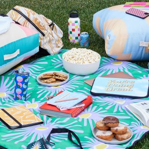 outdoor study session with snacks, tech gear, floor cushions and more