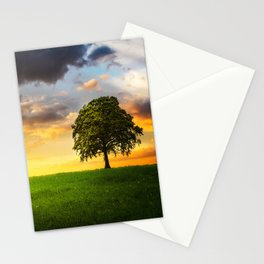 A lone tree under the cloudy sky in the field Stationery Cards