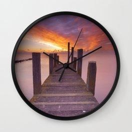III - Seaside jetty at sunrise on Texel island, The Netherlands Wall Clock