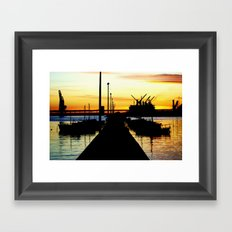 Light shines over the Harbour Framed Art Print