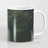 rowing Mugs featuring Rowing back home. by Nepal