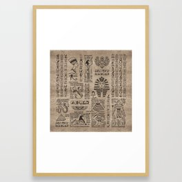 Egyptian hieroglyphs and symbols on wood Framed Art Print