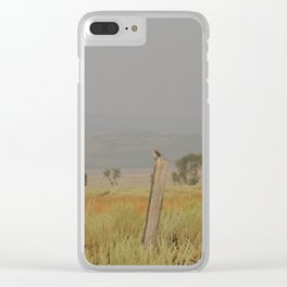 Bird perched after the rain at sunset Clear iPhone Case