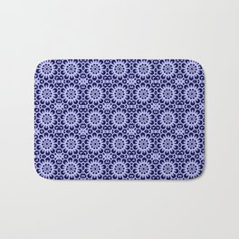 Lace of snow flakes on dark blue background Bath Mat