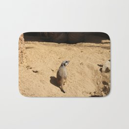 Little suricate looks around Bath Mat