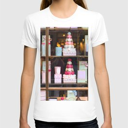Beautiful colorful tasty macaroons cakes sweets and presents in the boxes display in window at the  T-shirt