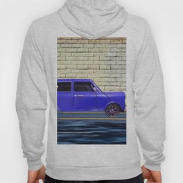 blue classic car on the road with brick wall background Hoody