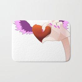 A hand catching a Heart Bath Mat