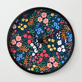 Vintage floral background. Flowers pattern with small colorful flowers on a dark blue background.  Wall Clock