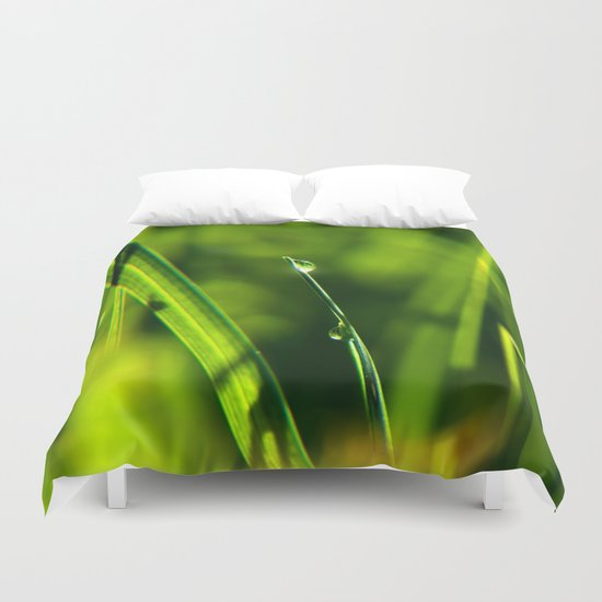 Dew on grass at early backlight Duvet Cover