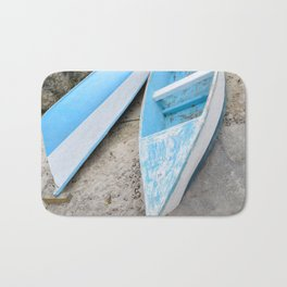 Two boats on the shore Bath Mat