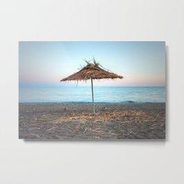 Straw umbrellas on the beach Metal Print