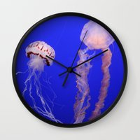 jelly fish Wall Clocks featuring jelly fish by Bunny Noir