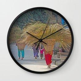 CARRYING GRASS FODDER THROUGH VILLAGE IN NEPAL Wall Clock