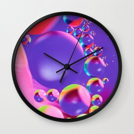 Colorful close up of oil drops in water Wall Clock