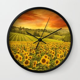 Red sunset over the rolling sunflowers and sunflower fields of Tuscany, Italy Wall Clock