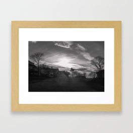 Streamers in the sky Framed Art Print