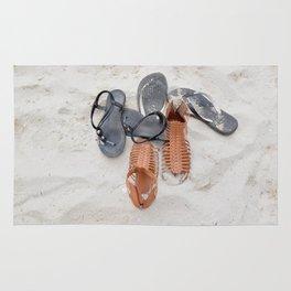Flip flops on sandy beach Rug