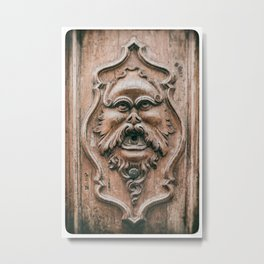 Face with beard carved on ancient door in Pisa Tuscany Italy Metal Print