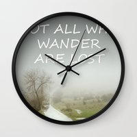 "tolkien Wall Clocks featuring ""Not all who wander are lost"".  J.R.R. Tolkien.  The Fellowship of the Ring by Guido Montañés"