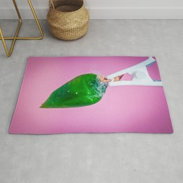 A green pupa of the tropical butterfly over pink background. Rug